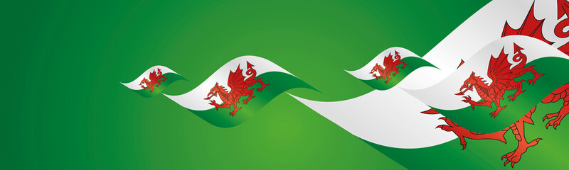 Wales Saint Davids Day waving flags two fold green landscape background