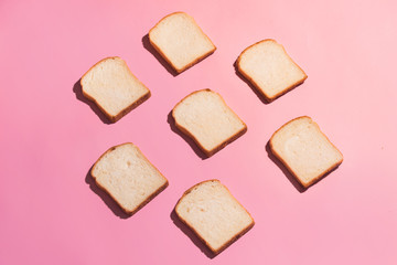 Sliced bread to toast isolated on pink background. Close up. Top view