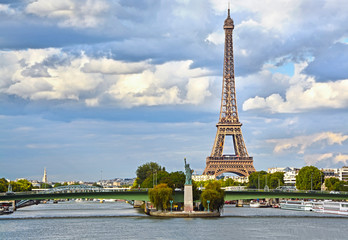 Eiffel Tower, Seine river and Statue of Liberty in Paris, France.