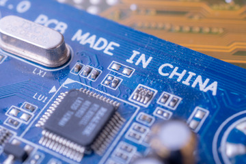 Made in china tag text on blue computer main board circuit
