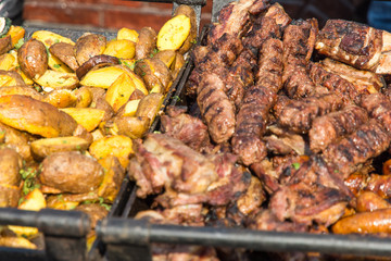 Fototapete - assorted grilled pork meat dishes prepared for festival