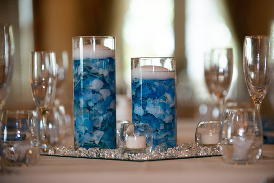 Floating candle centerpiece with blue flower pedals