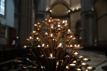 Many candles lights of interior of Cattedrale di Santa Maria del Fiore