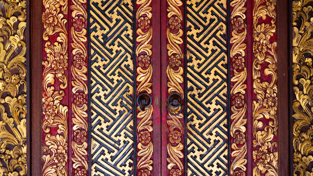 Beautifully decorated Indonesian wooden door in black red and gold