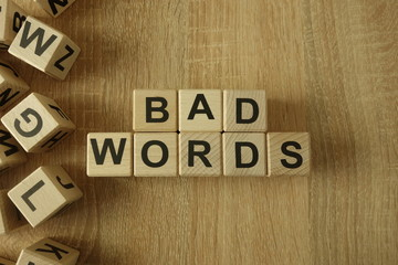 Bad words text from wooden blocks on desk