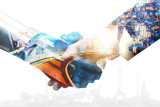 Cyber communication and robotic trend and artificial intelligence, autonomous car concepts. Industrial 4.0 Cyber Physical Systems concept. Robot and Engineer human holding hand with handshake.
