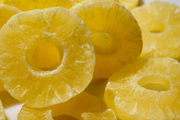 Fotobehang Plakjes fruit Dried pineapple candy rings, close-up.