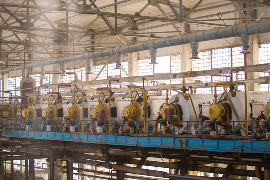 Theme industry and processing of agricultural crops. Equipment and machinery inside the old sugar factory of Soviet times.