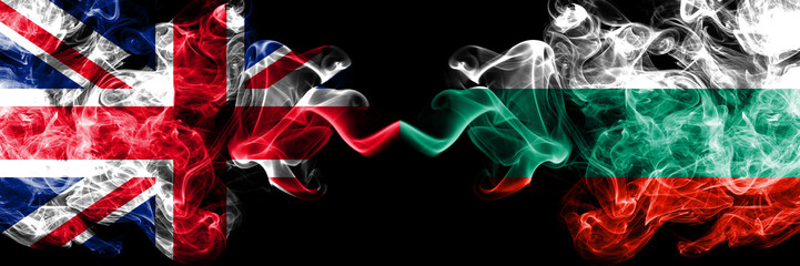 United Kingdom vs Bulgaria, Bulgarian smoky mystic flags placed side by side. Thick colored silky smoke flags of Great Britain and Bulgaria, Bulgarian.