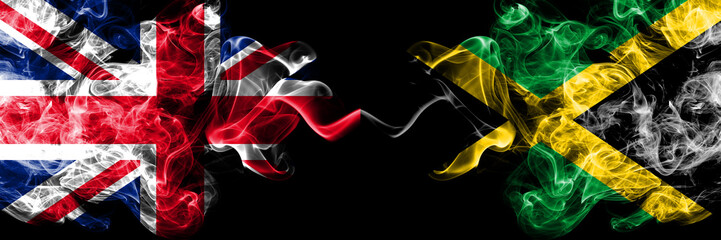 United Kingdom vs Jamaica, Jamaican smoky mystic flags placed side by side. Thick colored silky smoke flags of Great Britain and Jamaica, Jamaican. Wall mural
