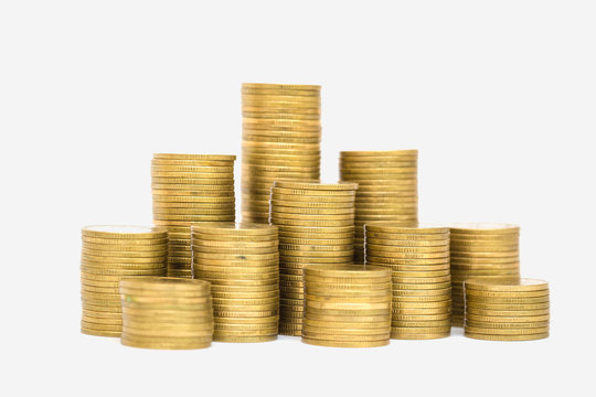 Gold coins stacks isolated on white background.