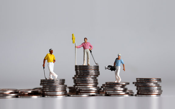 Miniature golfers standing on piles of coins at different heights.