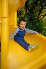 Asian kid on slide