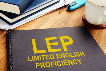 Limited English Proficiency LEP documents on a desk.
