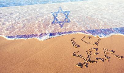 Beach sand, sea and flag Israel. I love Israel concept