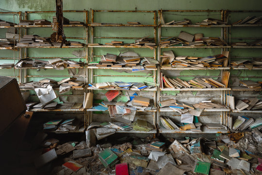 Abandoned bookstore with shelves full of worn books