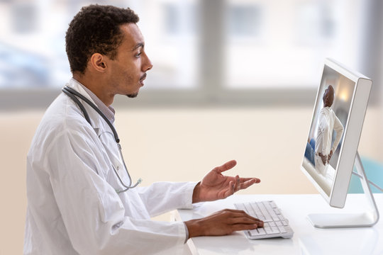 Telemedicine or telehealth concept, Doctor with a stethoscope on the computer laptop screen.