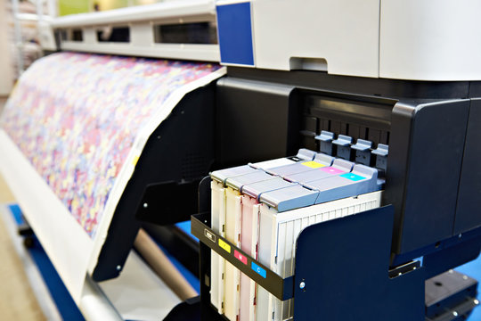 Wide format printer for on fabric and paper
