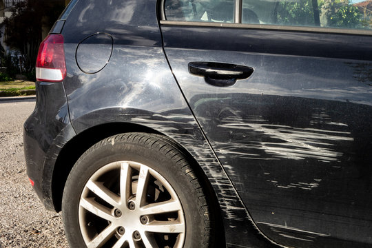 Black modern car scratched in traffic accident