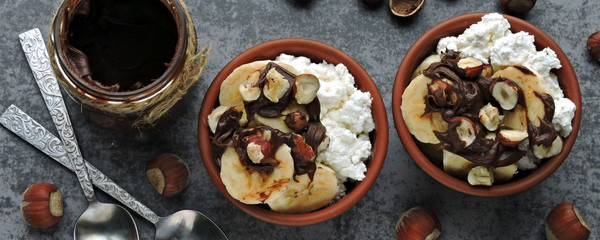 Healthy breakfast or snack with cottage cheese, banana and chocolate-nut paste. Keto diet. Keto dessert.