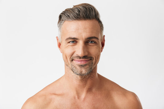 Closeup portrait of european half naked man 30s having bristle smiling at camera