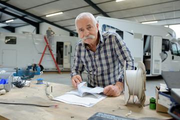 senior male worker in workshop