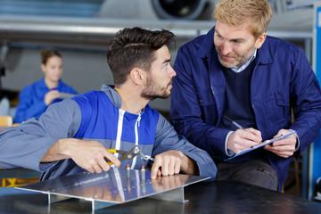 apprentice aerospace engineer asking tutor a question
