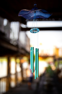 Wind bell hanging at front the door of traditional residential in Asia close up.