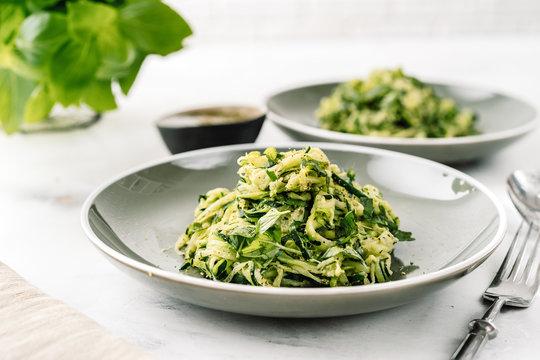 Zucchini vegan pasta on white background. Vegetarian healthy food