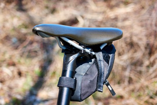 Bike seat pack under bicycle saddle. Small saddle pack attached with velcro