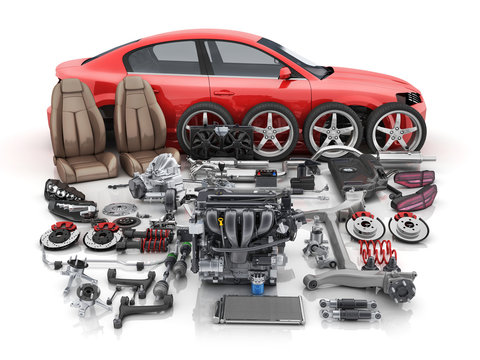 Red car body disassembled and many vehicles parts