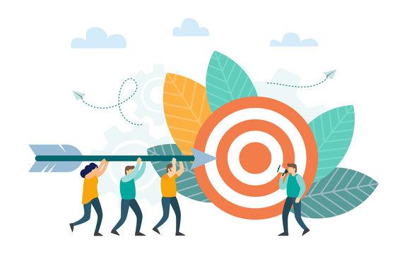 Successful businessman aiming arrow towards target