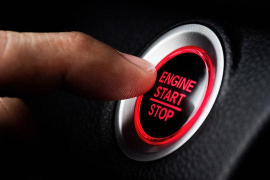 Finger pressing botton start or stop car engine