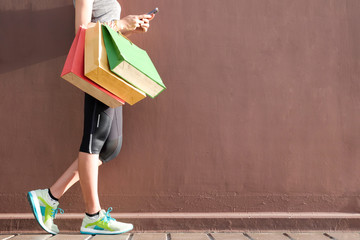 Women use smartphone shopping online , Fashion outfit stylish clothes. Carry a colorful shopping bag.