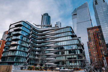 General view of 520 West 28th by Zaha Hadid and Hudson Yards from High Line Park in Chelsea New York City