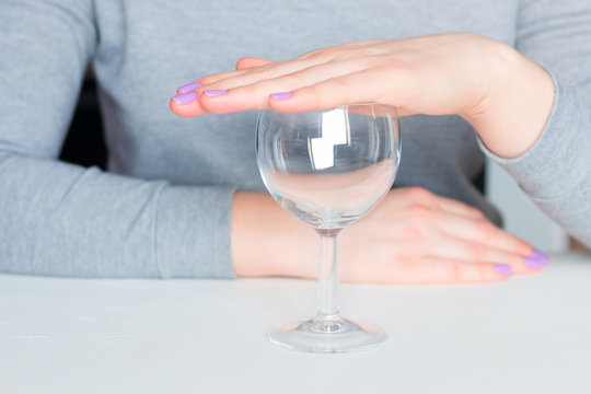 young woman and empty glass - refusal of alcohol