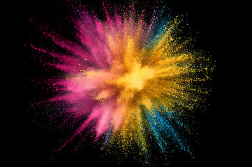 Colored powder explosion. Abstract closeup dust on backdrop. Colorful explode. Paint holi Wall mural