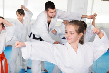 Children trying martial moves in karate class