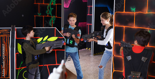 Kids playing laser tag on labyrinth