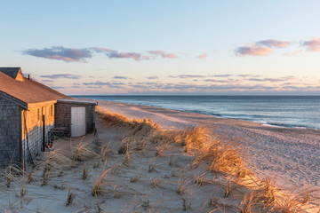 Sunlight lighting Building and Sand Dunes at Cape Cod with View of Ocean