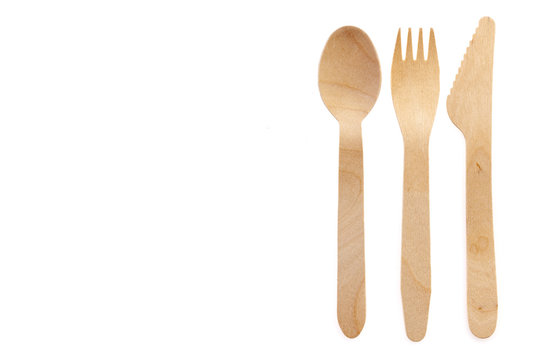 Eco-friendly materials. Wooden, disposable tableware on a white background.