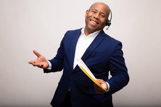 Happy African American Businessman Shrugs Shoulders