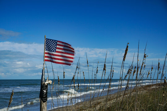 American Flag flying at the beach on a beautiful spring day in Florida.
