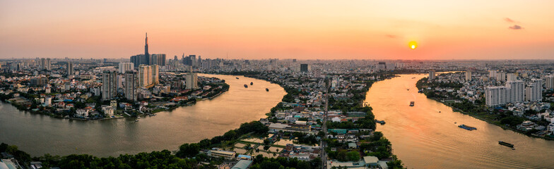 Aerial drone photo - Skyline of Saigon (Ho Chi Minh City) at sunset.   Vietnam