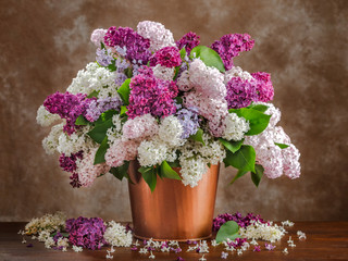 Wall Murals Lilac Still life lilac flowers in a vase on the table.