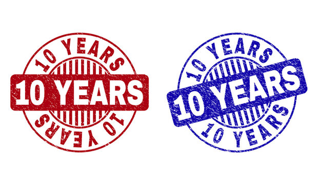 Grunge 10 YEARS round stamp seals isolated on a white background. Round seals with grunge texture in red and blue colors. Vector rubber overlay of 10 YEARS caption inside circle form with stripes.
