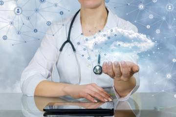 A doctor holding an information and data cloud above a tablet.