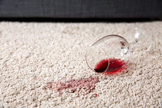 Glass of wine spilled on carpet