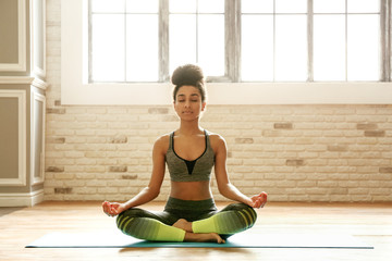 Printed roller blinds Yoga school Sporty African-American woman practicing yoga indoors