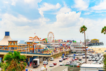 Famous Pier in Santa Monica with tourists, a suburb of Los Angeles.